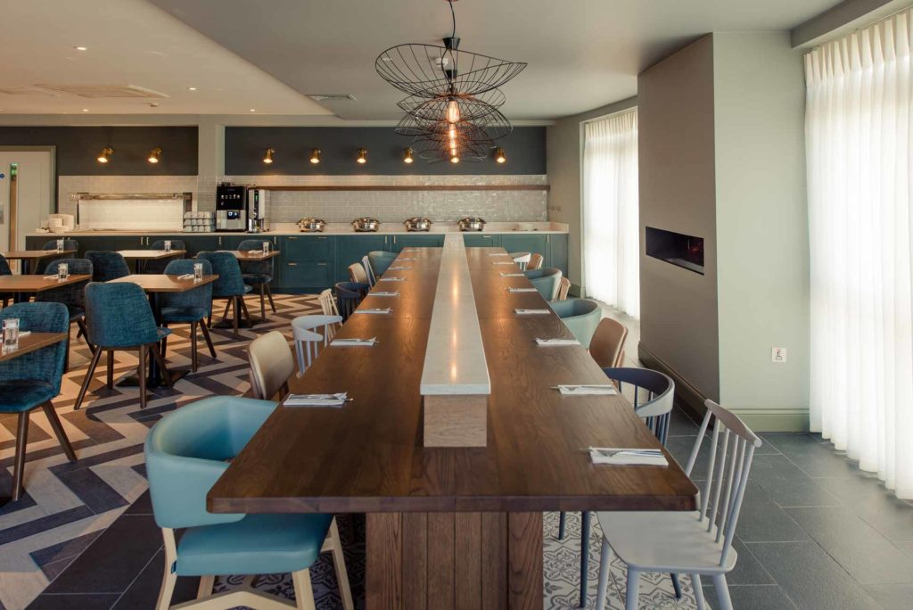 The Hoban Hotel Kilkenny refectory table in bright spacious 1801 Bar & Restaurant